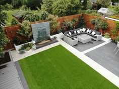 Modern water feature, artificial grass, Symphony Vitrified paving patio, timber sleepers and fence screening Back Garden Design, Small Backyard Design, Modern Garden Design, Backyard Patio Designs, Small Backyard Landscaping, Garden Landscape Design, Backyard Ideas, Garden Ideas, Modern Design