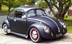 1970 VW Beetle. Flat black, red rims, chrome, with visor