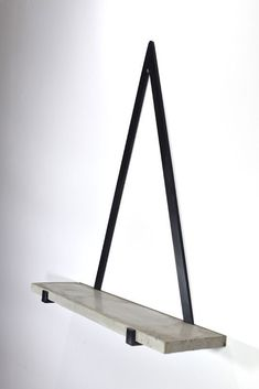 The Concrete Triangle Shelf is a beautiful and simple item which we are thrilled to have in our store. This elegant design would be perfect as a centre point of any room with a selection of styled home accessories adorning the shelf. The polished handmade concrete shelf combined with the gunmetal black is a really great mixture of materials. -The Concrete Triangle Shelf is rather heavy so would have to be hung from a solid wall. #concretefurniture