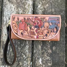 This clutch was inspired by the moonshiners who roamed the hills and hollers of the Appalachian region during the prohibition era. The hand tooled design on the front features a pin up style gal br...