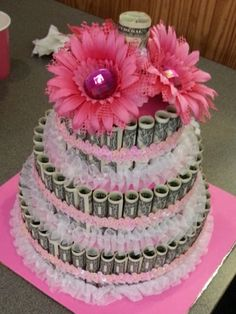 """Money cake! I used sewing pins to pin each dollar to the styrofoam """"cake"""" which took some practice. It was a time consuming thing, but I really liked how it turned out."""