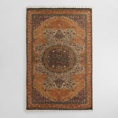 Hand woven of 100% natural jute and printed with an exclusive Persian-inspired design on a soft yellow background, our natural fiber area rug is stonewashed for a distressed finish.