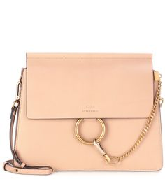 Chloé - Faye leather shoulder bag - Chloé's Faye bag is timeless and elegant – in textured beige-hued leather, it features a clean-cut boxy shape and is accented with a gold and silver-toned loop and chain detail. Go hands-free by wearing it cross-body, keeping all your essentials organised in the separate internal compartments. seen @ www.mytheresa.com