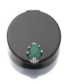 SILVER GILT, LACQUER, TURQUOISE AND DIAMOND POWDER COMPACT, CARTIER, CIRCA 1925 Circular, the thumb piece applied with a stylised foliate motif in carved turquoise and rose-cut diamonds, signed Cartier Made in France, French assay and maker's marks, numbered, measurements 52 x 18mm approximately, Cartier fitted case.
