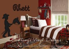 Cowboy Wall decal of a little cowboy riding a stick horse and Western style name is adorable! From brittanybach shop on etsy. Love the mix of patterns  in the fabrics of this kids' room.
