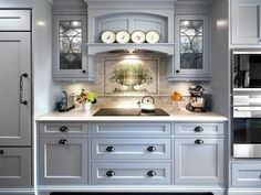 English Cottage Charm in English Cottage Charm from HGTV. English Cottage Charm  The hood mantel center arch is recessed with an added plate rail displaying the client's antique collection. Leaded glass doors on either side of the hood mantel create depth and add soft light.