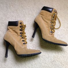 High heeled boots High heeled construction boots. Yellow and brown laces. They have some scratches and chips off the heel but it makes them look rustic. You could slay in these offers always appreciated! Xhilaration Shoes Heeled Boots