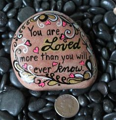 "Painted rock ""You are loved"""