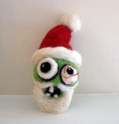 Santa Zombie Needle Felted Christmas Ornament. $20.00, via Etsy.  Gotta use this as inspriation for a Mike gift next year.  how funny