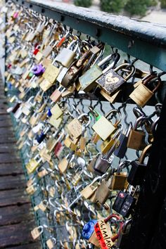 This is a bridge in Paris. You hang locks on it with the name of you & your boyfriend/girlfriend/bestfriend then throw the key into the river. So even though the friend/relationship may end, you can't remove the lock. It stays there forever, as relevance to someone once a part of your life. So cute!