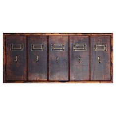 Distressed wood and metal wall rack with 5 hooks and accompanying name plates.   Product: Wall rackConstruction Mat...