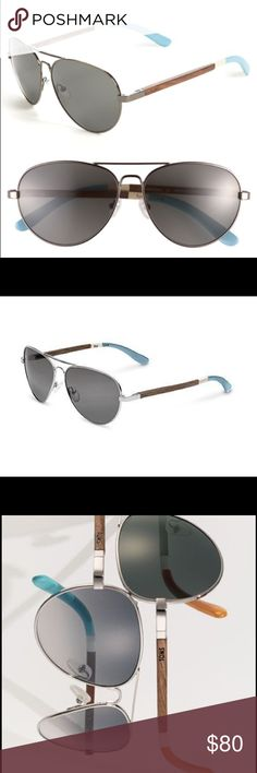 Maverick 301 Aviator Sunglasses - TOMS - NEW Maverick 301 Aviator Sunglasses - TOMS- New in case, never worn. The case has a few marks from being in a drawer with other sunglasses.  Details: metal aviators w/ genuine walnut wood temples finished w/ hand-painted stripes. made in Italy. 100% UVA/UVB sun protection. Unisex. Metal/wood w/ wire-core temples. Double bridge w/ brow bar accent. Frosted silicone nose pads provide a custom fit. Brand name engraved at temple. Spring hinges provide a…