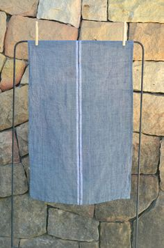 A generous size, pure linen, soft cloth that can either be used as a bistro-style apron or a kitchen cloth. The linen is woven with either a stripe or cross