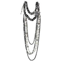 CHANEL Long Chain Necklace 'Paris-Edinburgh' in Tweed and Glass Pearls    From a unique collection of vintage multi-strand necklaces at https://www.1stdibs.com/jewelry/necklaces/multi-strand-necklaces/