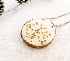 Pressed Flower Wood Pendant - Handmade Resin jewelry for nature lovers. $30.00, via Etsy.
