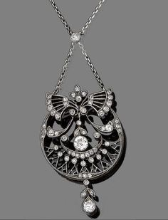 A diamond pendant necklace, circa 1910  The circular pierced plaque with stylised ribbon surmount, set throughout with single and old brilliant-cut diamonds, to a trace-link chain, diamonds approx. 1.25ct total, Austrian assay marks, lengths: chain 45.8cm, pendant 6.7cm