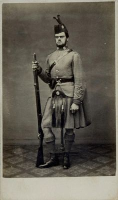 Scottish Rifle Volunteer soldier with rifle by Symons of London. Dated 1862