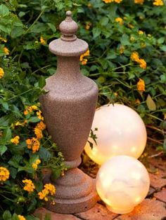 DIY Garden Decoration - AllYou.com. Sculpt a stonelike ornament for your garden. Materials: old lamp base, plaster of paris dry mix, measuring cup, bucket or bowl, water, old spoon, finial(type meant for end of a curtain rod), gorilla glue, sandpaper, Krylon Make It Stone spray paint