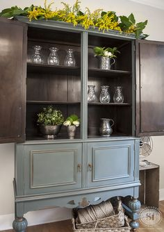 Painted and original stained Vintage Cabinet. This would look amazing in the corner of my living room!