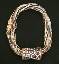 https://flic.kr/p/c1a9a7 | Bohemian Barrel Bead Necklace | Multiple cords and magnetic closure can be doubled as shown here or opened up to be worn long.