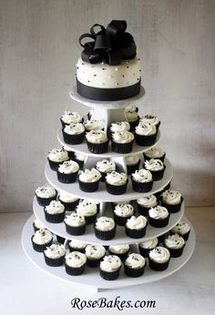 Cupcake wedding cake...more than 50 single cupcakes for each guest. Cake at top for bride and groom. Not black and white though.