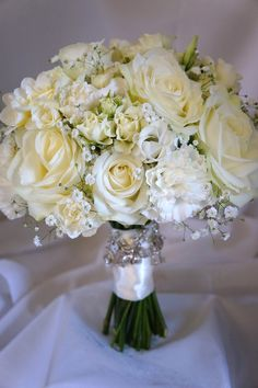 Beautiful wedding bouquet styled with Avalanche by Meijer Roses. Designed by Green Room Flowers.