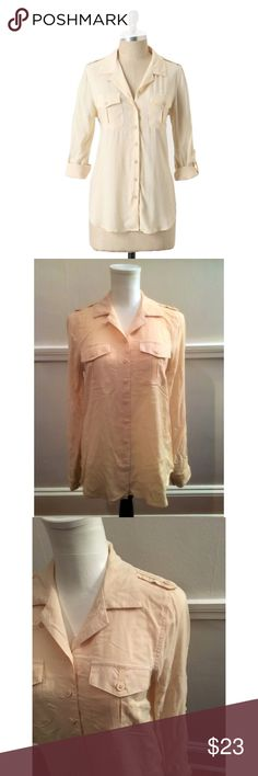 """Odille Anthro Sz 0 """"Hasbrouck Button-Up"""" Top EUC Odille Anthro Sz 0 """"Hasbrouck Button-Up"""" Top. This Ivory cream woven rayon blouse by Odille has full length rolled tab option sleeves, shoulder epaulettes, camp pockets at the bust and a button up front. Labeled a 0 but runs bigger than that. (Fits my size 4 mannequin) Pre owned, has been washed and worn, Great condition. Anthropologie Tops Button Down Shirts"""