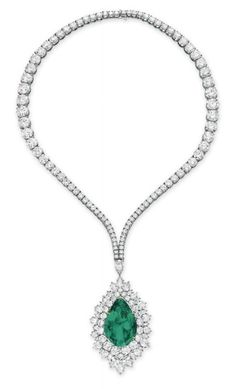 AN EMERALD AND DIAMOND PENDANT NECKLACE, BY HARRY WINSTON