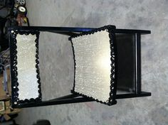 Upcycled wood folding chair painted black added gold covers and black sequin trim w/ antique buttons.  $20.00