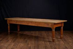 AntiqueLarge Rustic American Pine Dining or Library Table with Pine Slatted Plank Top and Large Turned Legs Georgia Store Display Table,Circa 1920's Exceptional Aged Patina with Original Hand Crafted Details Low Apron May Require Adjustment for Dining Chair Clearance Perfect as Library Book Table