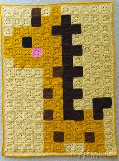 "Crochet 8-Bit Pixel Art Baby Blanket--Baby Giraffe by simplyhappycreations (154 solid 2"" granny squares,  it measures approximately 32"" x 42"")."