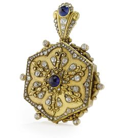 A Russian Gold and Jeweled Pendant Locket, Eduard Wilhelm Schramm, St. Petersburg, circa 1890, of hexagonal form, the six panels set with diamonds and sapphires, the suspension ring also set with diamonds and sapphires, the six panels opening to reveal a glazed circular aperture.