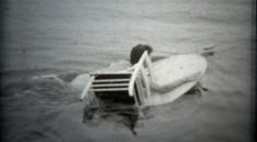 1960: Women trick water skiing with a stunt table and circus chair. http://www.pond5.com/stock-footage/57400164?ref=StockFilm keywords:women, trick, waterski, stunt, chair, table, spin, twirl, sport, professional, black and white, boating, bikini, famous, celebrity, athlete, showboat, 1960s, 8mm, film, old, times, tv, commercial, home movie, vintage, retro, archive, nostalgia, memories, throwback, Americana, documentary, editorial, historic, preserve, restore, real, classic, era, priceless…