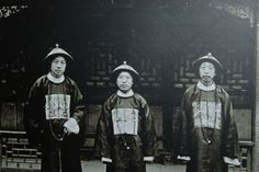 Eunuchs in Court attire during the Qing Dynasty, late 19th to early 20th century.