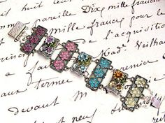 $85  Hundreds of Swarovski crystals embellish this elegant romantic bracelet. Colorful and floral, this bracelet is a must-have when you want to dress up wrist in seconds!