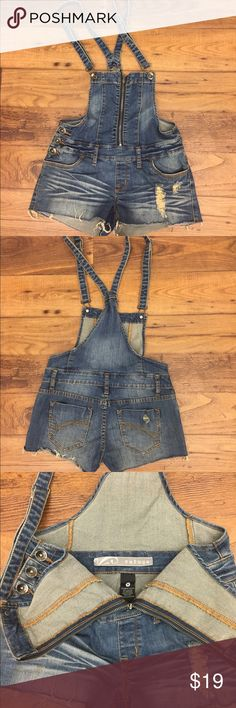 Distressed jeans shorts overalls Cute small Jean overall with a zipper in the front. No damage, smoke free/pet free home. refuge Jeans