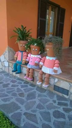 Too cute. Made out of flower pots.