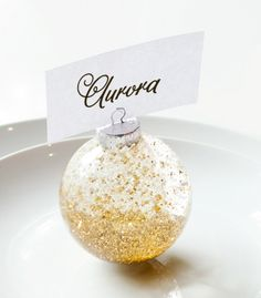 These would be great for a holiday wedding! // DIY Confetti Snow Globe Place Card Holder via Confetti Pop