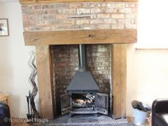 Wood Burner With Wooden Mantle Brick Surround And Terracotta Tiles Extension Pinterest