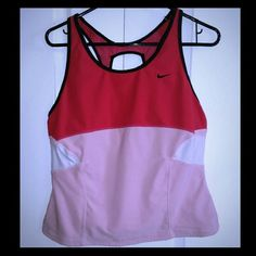 XL Nike hot pink, baby pink workout top NIKE FIT DRY workout top hot pink, baby pink, black and white.  Easy breathing fabric across back. I bought this too large and quickly lost weight making it way too big. Great condition - one small snag (unnoticeable when worn) shown up close in last picture.  If you like it make me an offer.  I can also bundle with other things in my closet at a discount.  I have other Nike, Victoria's Secret, Betsey Johnson and more so shop away! 2 Nike Tops