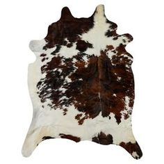 Anchor your living room seating group or define space in the den with this chic cowhide rug, featuring a natural silhouette for organic appeal.  Product: RugConstruction Material: CowhideColor: White, brown and blackDimensions: 6' x 7'Note: Size is approximate. Please be aware that actual colors may vary from those shown on your screen. Accent rugs may also not show the entire pattern that the corresponding area rugs have.Cleaning and Care: Professionally clean only