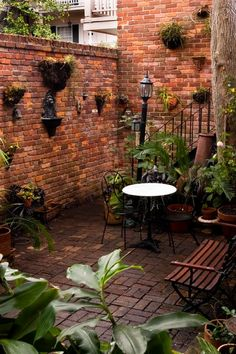 narrow walkway behind house;  North Rampart Street - French Quarter - traditional - patio - new orleans - Reform Architects