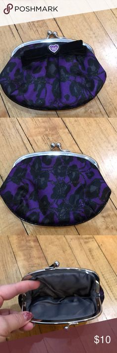 Coach coin purse purple and black Coach coin purse. Purple background with black design. Black felt bow with purple Coach embellishment. Gray inside. Smoke free home Coach Bags Wallets