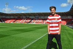 Doncaster Rovers sign Louis Tomlinson of One Direction