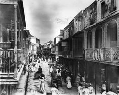 Beautiful, evocative image of Swan Street in Bridgetown, Barbados around 1900. Love the ornate balconies and the women on the right/front, carrying things on their heads.