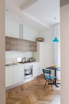 white + wood roman kitchen