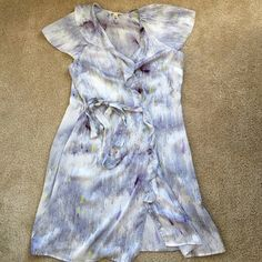 Silk ink splatter print Banana Republic dress Beautiful silk Banana Republic dress with era around waist ties and asymmetrical ruffling at neckline, throughout. Off white with dark purple and chartreuse patterns. Size M. Label discolored, otherwise in excellent condition. Banana Republic Dresses