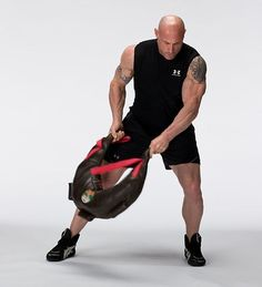 Minimalist Training: How to Make and Use a Bulgarian Training Bag -- Depending on your exercise selection, the Bulgarian Training Bag can be used to target the legs, shoulders, core, upper back, triceps, biceps, and forearms.