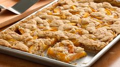 Serving a crowd? Treat your group of guests with this peach slab pie made using Pillsbury™ pie crust and cookie dough. A mouth-watering dessert that's great served with a scoop of cinnamon ice cream!