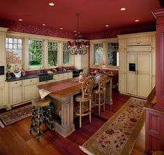 This smaller Visbeen Associates designed kitchen is especially warm.